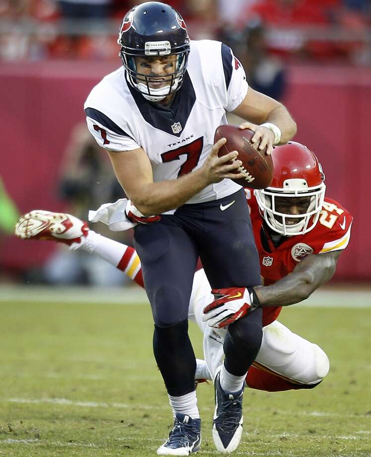 Case Keenum is sacked by Kansas City Chiefs cornerback Brandon Flowers during the fourth quarter. Photo: Brett Coomer, Houston Chronicle