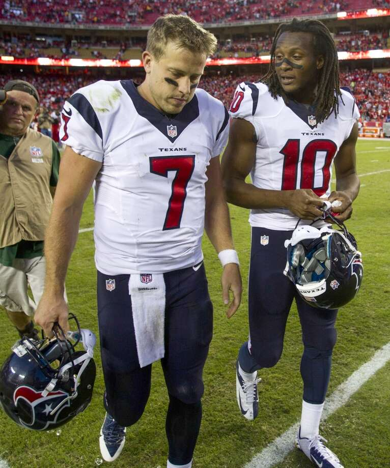 Case Keenum and wide receiver DeAndre Hopkins (10) walk off the field after the loss. Photo: Brett Coomer, Houston Chronicle