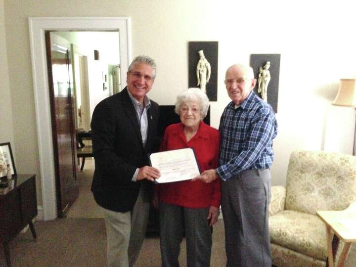 Assemblyman Jim Tedisco presents an Assembly citation to Adeline Morrett on her 100th birthday this