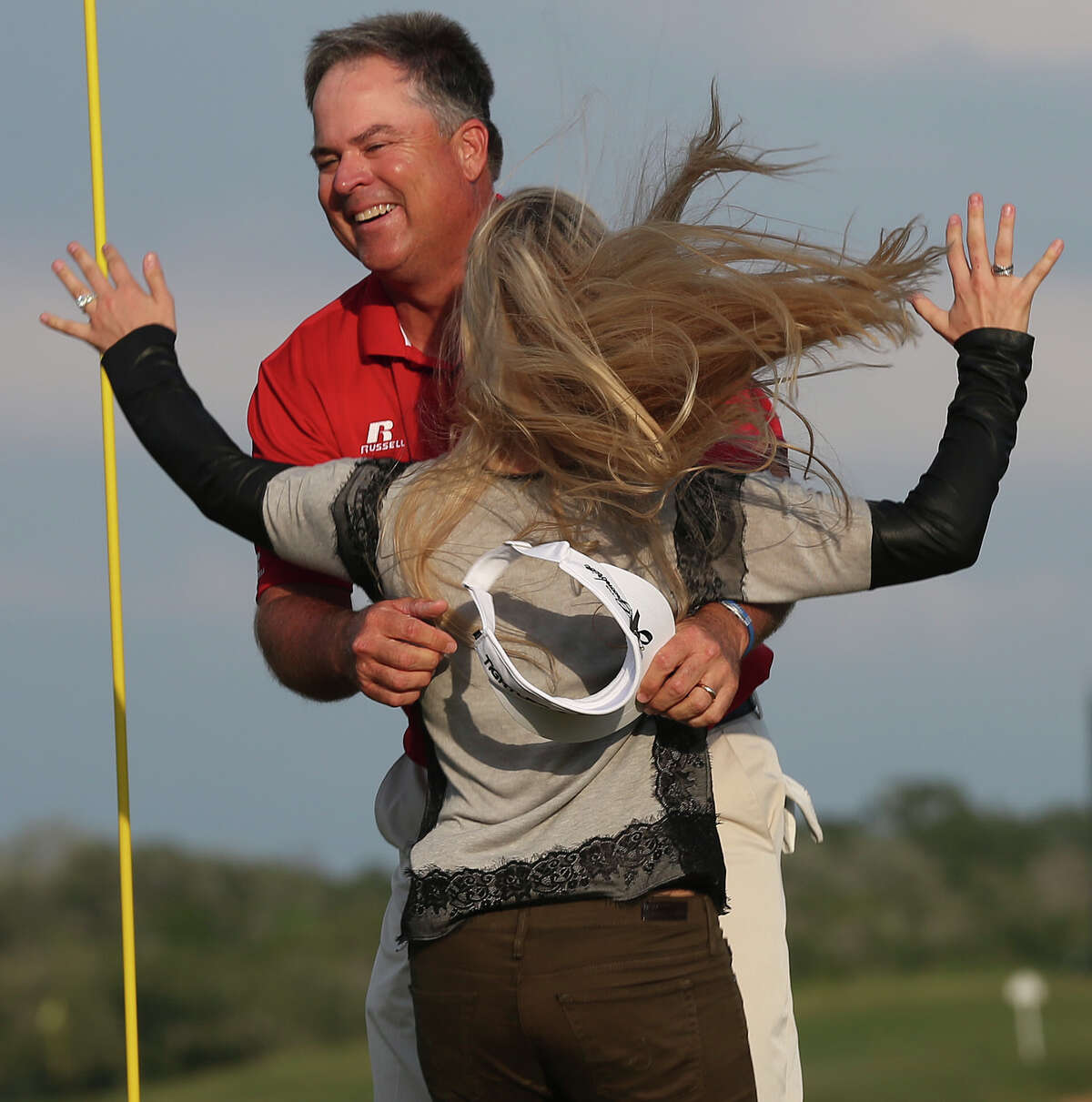 Kenny Perry, right, celebrates with his daughter, Lindsey Kennemer after winning the AT&T Championship at the TPC San Antonio Canyons Course, Sunday, Oct. 27, 2013. Perry, of Franklin, New York beat Bernhard Langer of Munich, Germany in a one-hole sudden death playoff to for a 13-under-par round.