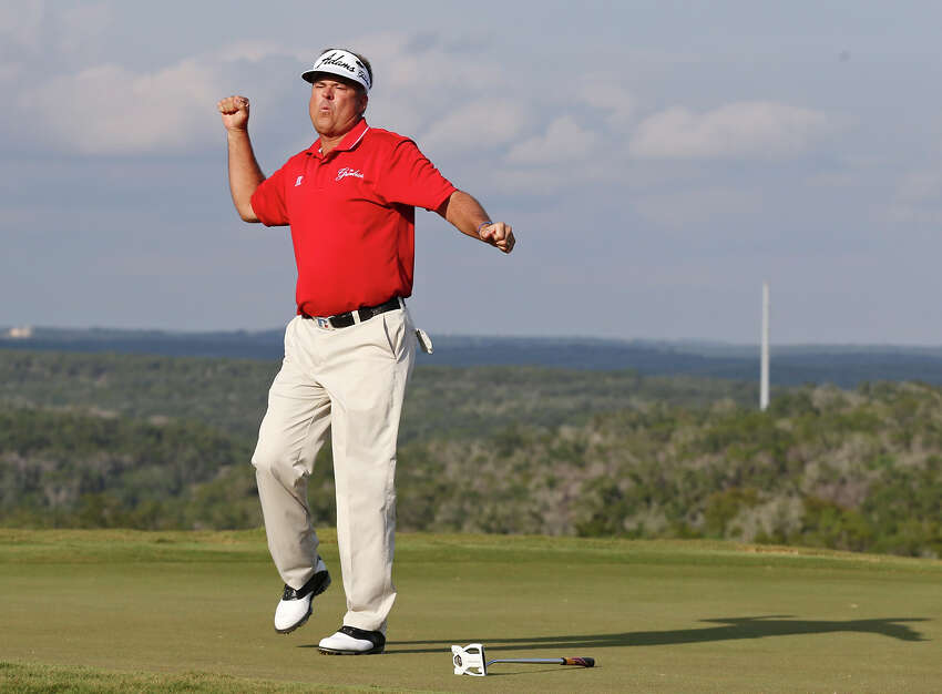 Kenny Perry reacts after making a putt on No. 18 to par the hole and setup a one-hole sudden-death playoff against Bernhard Langer Sunday Oct. 27, 2013. Perry went on to win the 2013 AT&T Championship on the AT&T Canyons Course at TPC San Antonio.