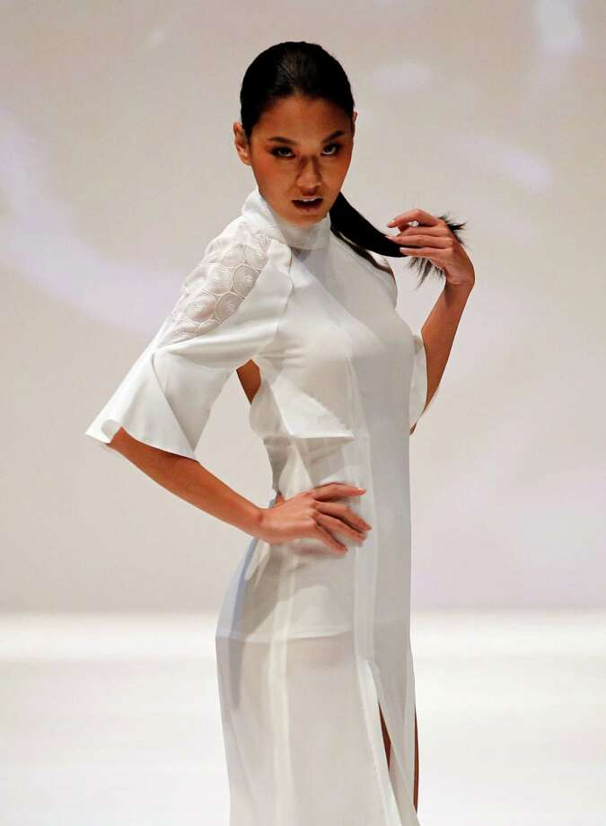 A model displays a creation from Taiwan designer Chun Ting Liu during the Taipei IN Style fashion show in Taipei, Taiwan, Wednesday, Oct. 16, 2013. Photo: Wally Santana, AP / AP2013