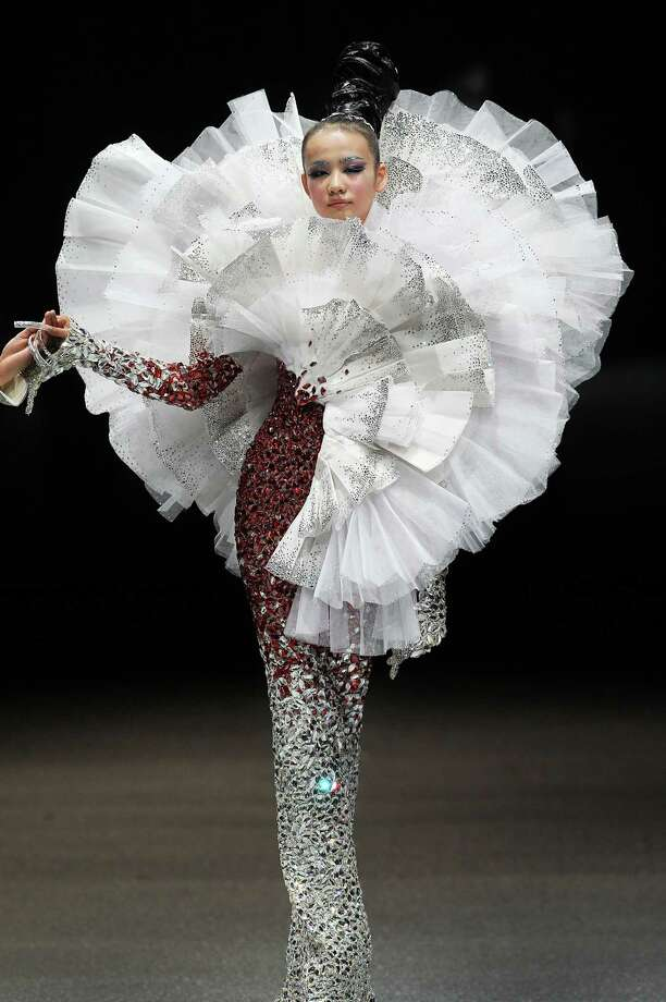 A model showcases an outfit by Chinese fashion designer Guo Pei, Wednesday Oct. 16, 2013, in Singapore during the Fide Fashion Week 2013 Asian Couture show. Photo: Wong Maye-E, AP / AP2013