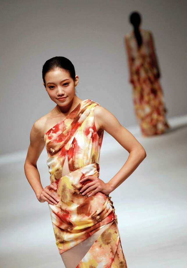 A model displays a creation by Taiwanese designer Crystal Wang during the Taipei IN Style fashion show in Taipei, Taiwan, Wednesday, Oct. 16, 2013. Photo: Wally Santana, AP / AP2013