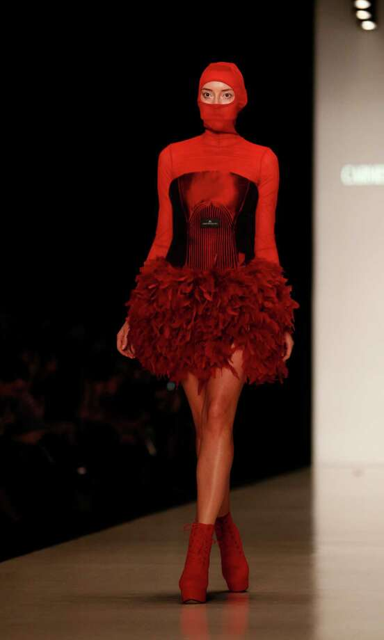 A model displays a creation by Romanian designer Carmen Emanuela Popa during Moscow Fashion Week in Moscow, Russia Sunday, Oct. 27, 2013. Photo: Alexander Zemlianichenko Jr, AP / AP