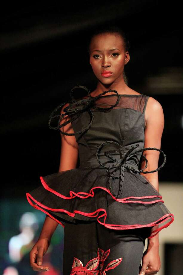 A model displays an outfit by designer Valerie David, during the Lagos Fashion and Design Week in Lagos, Nigeria, Wednesday, Oct. 23, 2013. Photo: Sunday Alamba, AP / AP