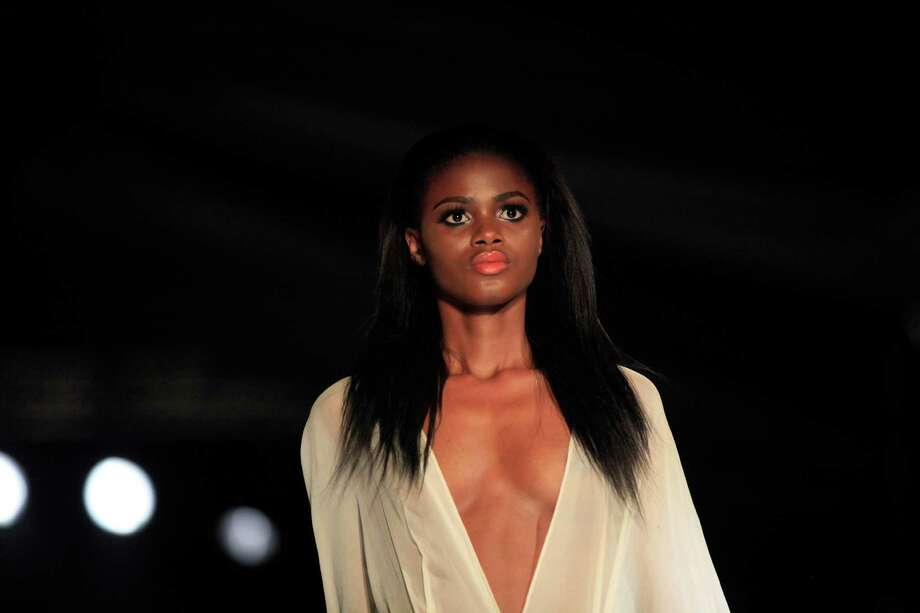 A model displays an outfit by designer Shola Ajayi, during the  second day of Lagos Fashion and Design Week in Lagos, Nigeria, Thursday, Oct. 24, 2013. Photo: Sunday Alamba, AP / AP