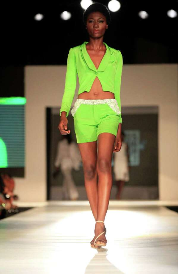 A model displays an outfit by designer Grey Washington Roberts during the  Lagos Fashion and Design Week in Lagos, Nigeria, Friday, Oct. 25, 2013. Photo: Sunday Alamba, AP / AP