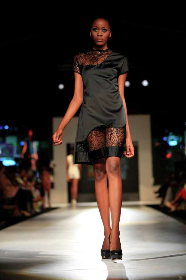 A model displays an outfit by designer Iconic Ivanity, during the  Lagos Fashion and Design Week in Lagos, Nigeria, Friday, Oct. 25, 2013. Photo: Sunday Alamba, AP / AP