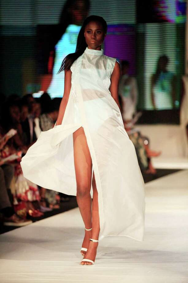 A model displays an outfit by designer Shola Obebe, during the  Lagos Fashion and Design Week in Lagos, Nigeria, Saturday, Oct. 26, 2013. Photo: Sunday Alamba, AP / AP