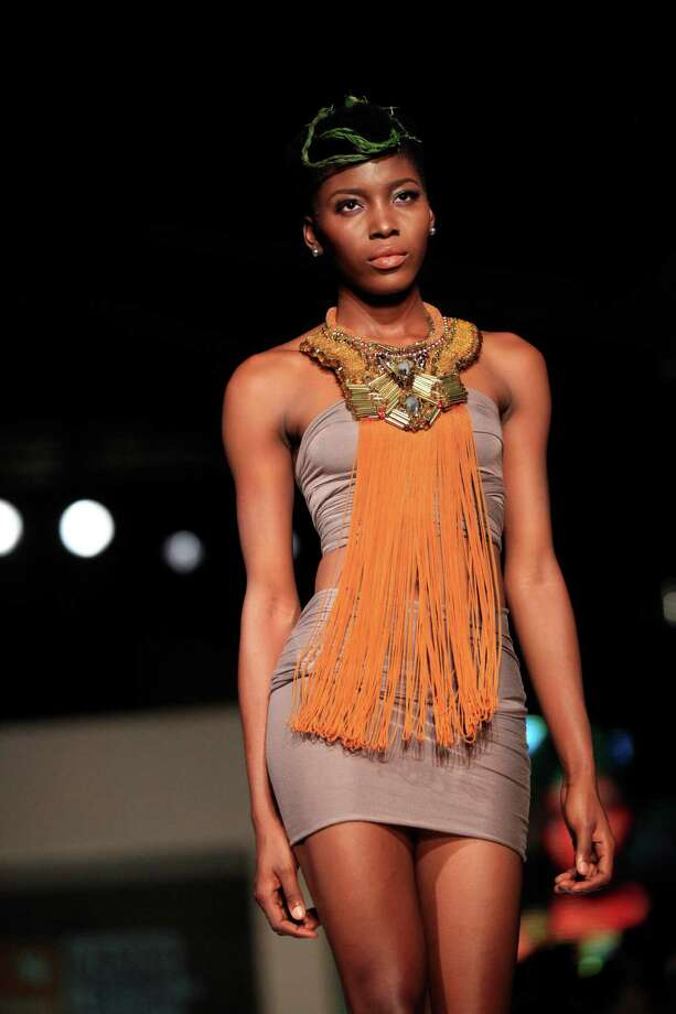 A model displays an outfit by designer Anita Quansah + Mo Saique, during the Lagos Fashion and Design Week in Lagos, Nigeria, Saturday, Oct. 26, 2013. Photo: Sunday Alamba, AP / AP