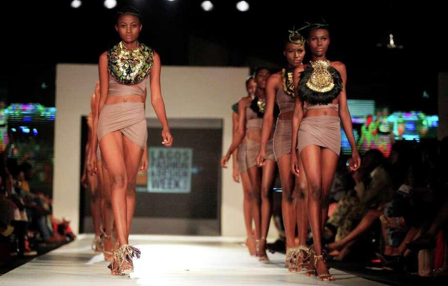 A model display outfits by designer Anita Quansah + Mo Saique, during the Lagos Fashion and Design Week in Lagos, Nigeria, Saturday, Oct. 26, 2013. Photo: Sunday Alamba, AP / AP