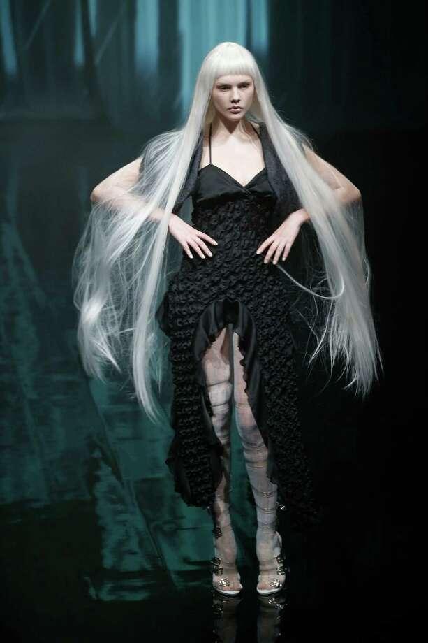 A model displays creations designed by Yasutaka Funakoshi of Japan during the 2014 Spring/Summer collection of the Tokyo Fashion Week in Tokyo, Saturday, Oct. 19, 2013. Photo: Koji Sasahara, AP / AP
