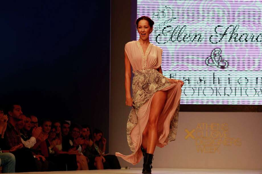 A model presents an outfit by Greek fashion designers Elen S. and  Erotokritos  during the Athens Exclusive Designers Week  on Sunday, Oct. 20 2013. More than twenty Greek  fashion designers  take part at the annual designers week, presenting their collections for Spring - Summer 2014. Photo: Kostas Tsironis, AP / AP