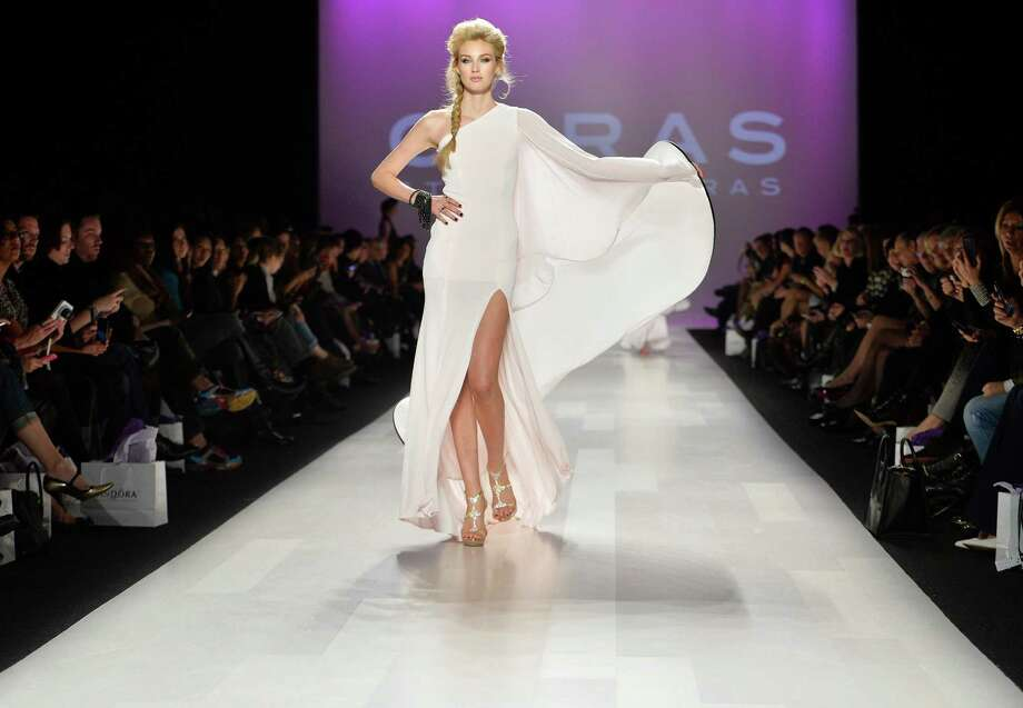 A model shows a creation from Stephan Caras while walking the runway during Toronto Week in Toronto on Friday, Oct. 25, 2013. Photo: Nathan Denette, AP / AP2013