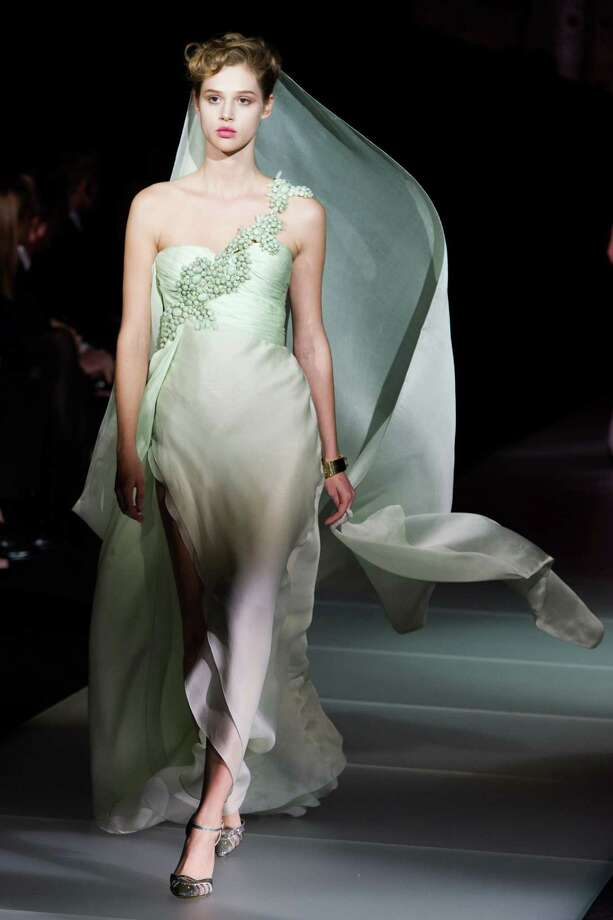 """A model walks the runway during Giorgio Armani's """"One Night Only New York� fashion show on Thursday, Oct. 24, 2013 in New York. Photo: Charles Sykes, AP / AP2013"""