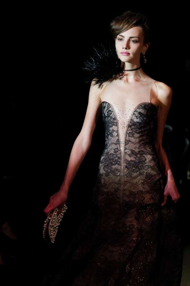 "A model walks the runway during Giorgio Armani's ""One Night Only New York� fashion show on Thursday, Oct. 24, 2013 in New York. Photo: Charles Sykes, AP / AP2013"