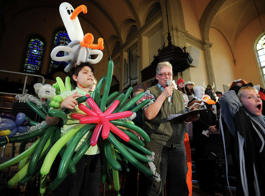 "Unable to sit down in his balloon costume of the movie Finding Nemo, Mark Russo, 15, of Trumbull, left, wins a best costume prize at the 12th Annual ""Pipescreams!"" concert at United Congregational Church in Bridgeport, Conn. on Sunday, October 17, 2013. The concert featured a variety of performers on the organ, piano and strings, along with a variety of choirs performing both individually and together. Photo: Brian A. Pounds / Connecticut Post"