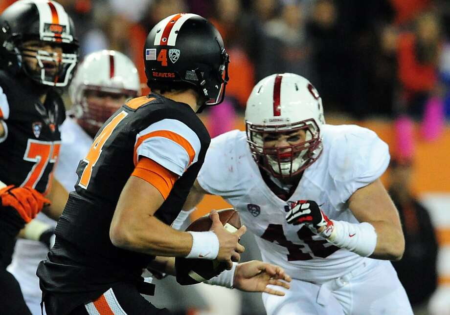Stanford linebacker Kevin Anderson (right) had 1 1/2 sacks among his five tackles in the Cardinal's win over Oregon State. Photo: Steve Dykes, Getty Images