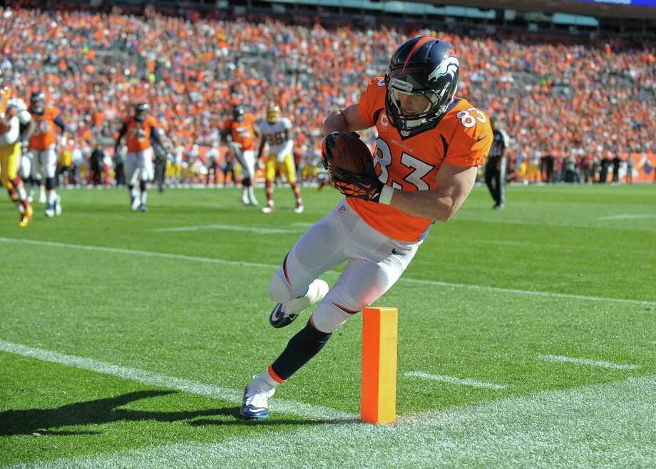 Denver Broncos wide receiver Wes Welker (83) steps across the goal line for a touchdown against the Washington Redskins in the first quarter of an NFL football game, Sunday, Oct. 27, 2013, in Denver. (AP Photo/Jack Dempsey)  ORG XMIT: COJJ104 Photo: Jack Dempsey / FR42408 AP