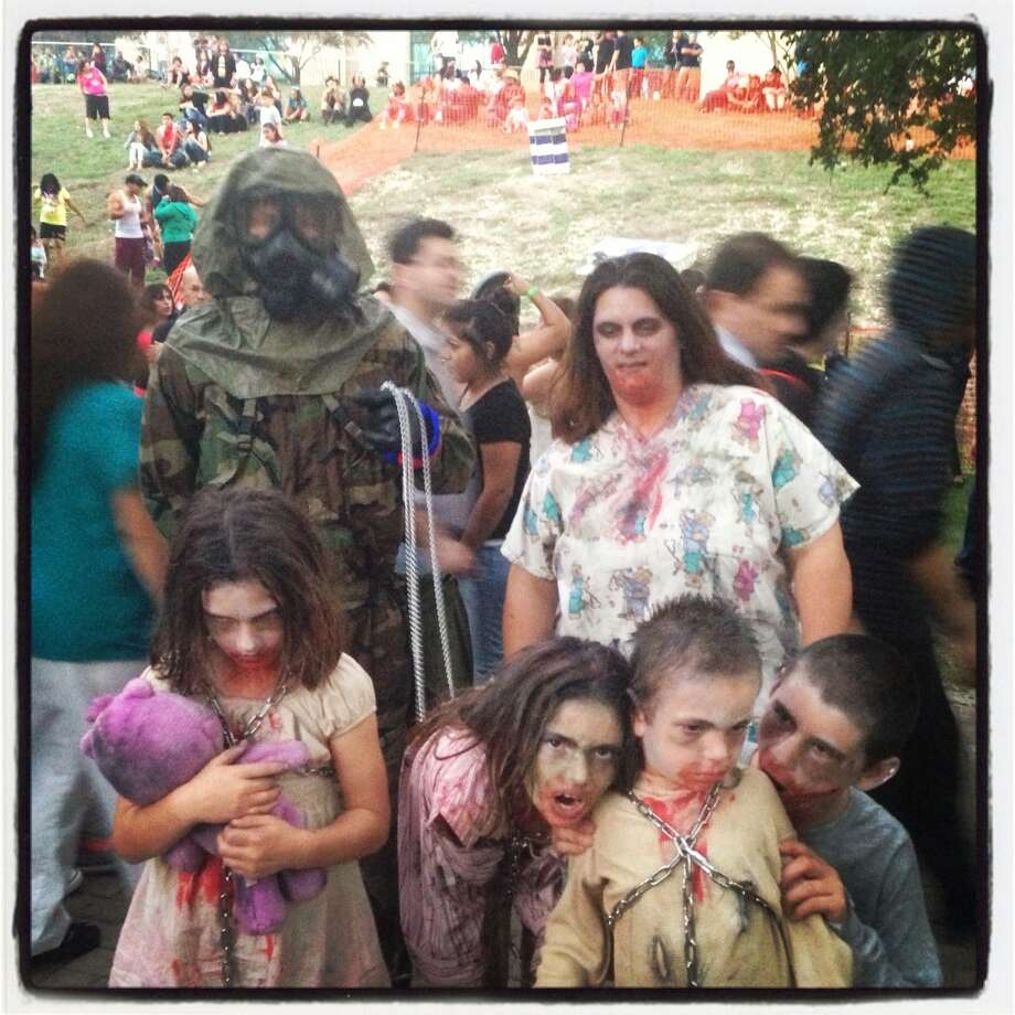 The family that slays together is probably undead together. The Roses go all out for the Zombie Walk. Photo: Benjamin Olivo, MySA.com