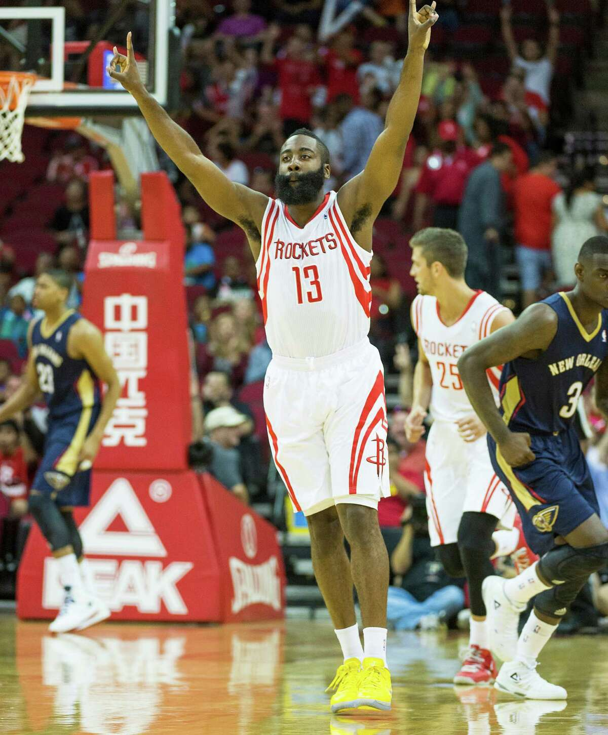 Houston Rockets shooting guard James Harden celebrates after hitting a 3-pointer during the first half of an NBA preseason basketball game against the New Orleans Pelicans at Toyota Center on Saturday, Oct. 5, 2013, in Houston. ( Smiley N. Pool / Houston Chronicle )