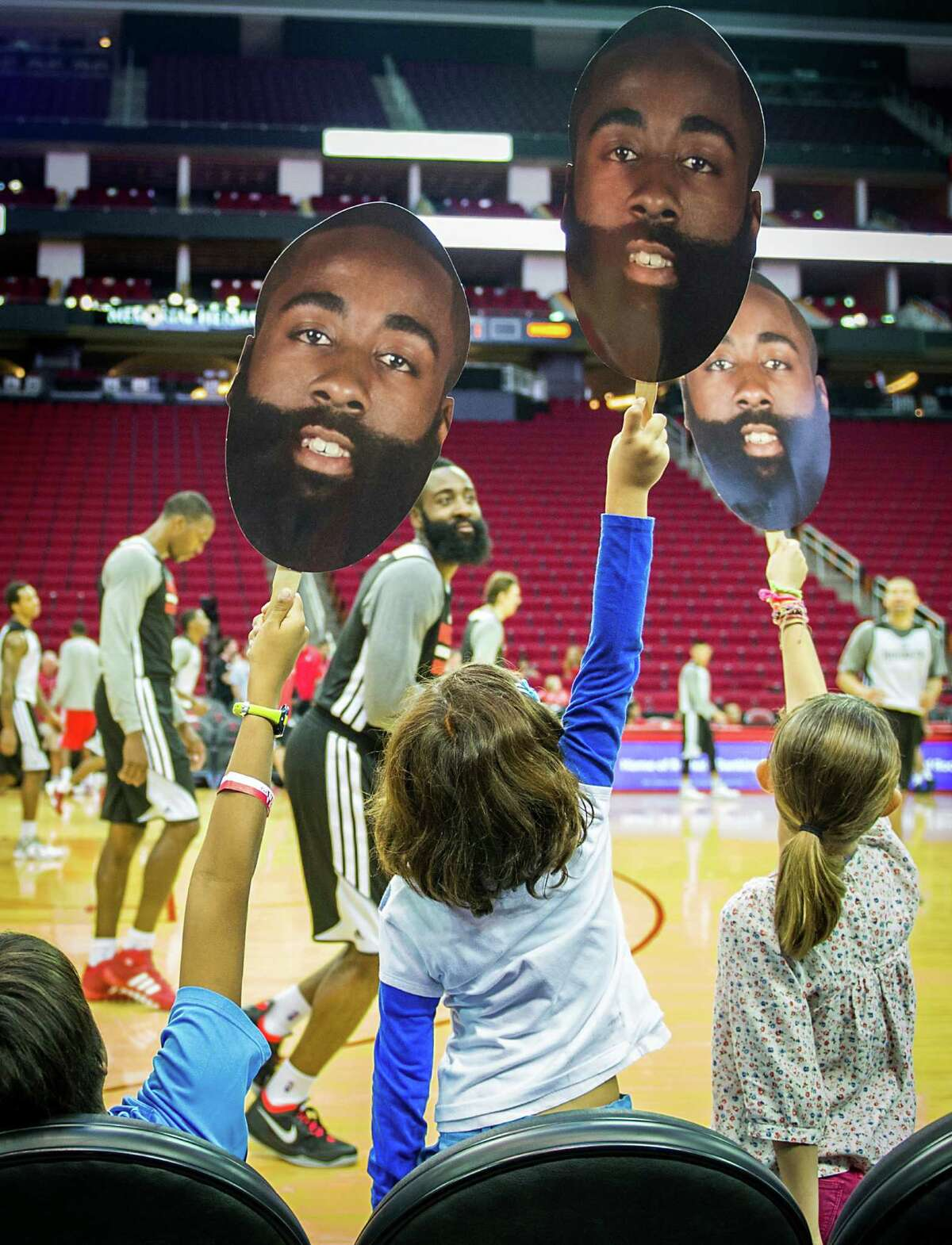 Fans at an open practice Sunday at Toyota Center show their devotion to Rockets shooting guard James Harden, who smiles in appreciation. The sentiment took root early when, in Harden's first game as a Rocket last season, he scored 37 points.