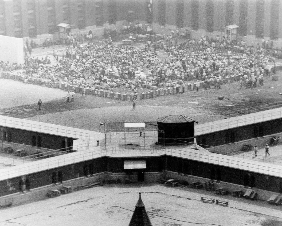 In this Sept. 9, 1971 file photo, prison guard hostages and inmate gather in the exercise yard of Cellblock D, inside Attica State Prison in Attica, N.Y. New York's Attorney General Eric Schneiderman has asked a state judge to unseal documents about the 1971 riot and retaking of Attica state prison in the nation's bloodiest prison rebellion. (AP Photo/ Buffalo Evening News, File)