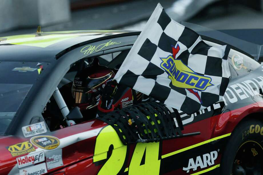 MARTINSVILLE, VA - OCTOBER 27: Jeff Gordon, driver of the #24 Drive To End Hunger Chevrolet, celebrates after winning the NASCAR Sprint Cup Series Goody's Headache Relief Shot 500 Powered By Kroger at Martinsville Speedway on October 27, 2013 in Martinsville, Virginia.  (Photo by Geoff Burke/Getty Images) ORG XMIT: 159337836 Photo: Geoff Burke / 2013 Getty Images