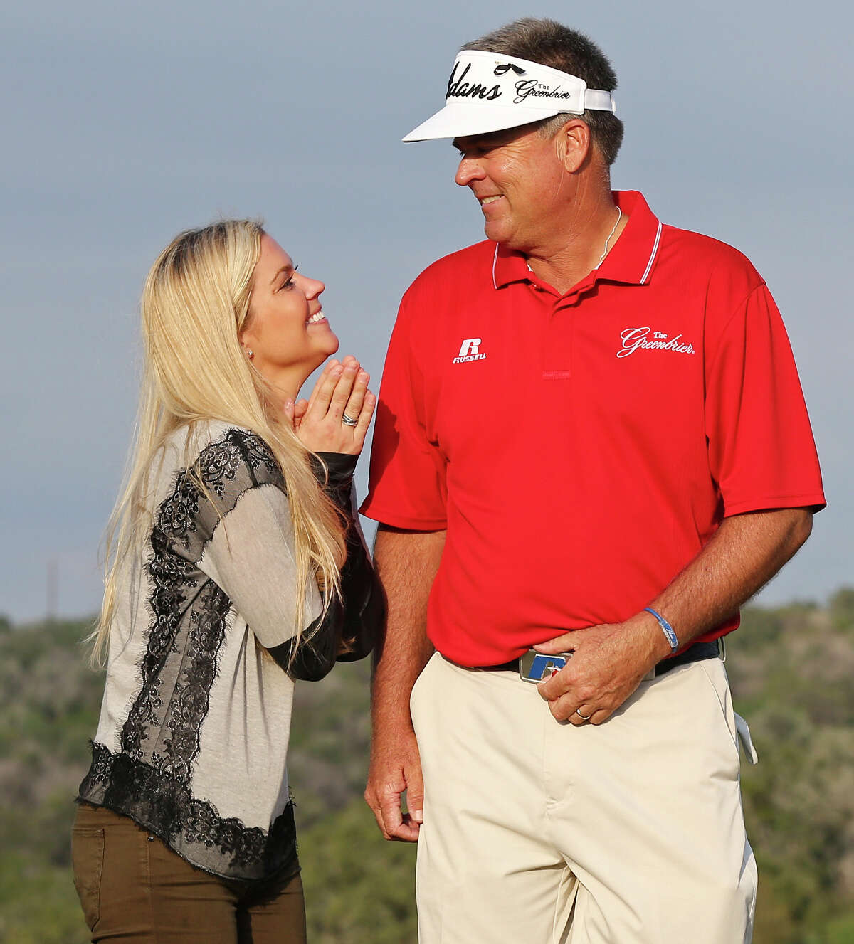Lindsey Kennemer (left) celebrates with her father Kenny Perry after he won a one-hole sudden-death playoff against Bernhard Langer to win the 2013 AT&T Championship Sunday Oct. 27, 2013 on the AT&T Canyons Course at TPC San Antonio.