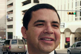 U.S. Rep. Henry Cuellar, D-San Antonio, arrives outside federal court Thursday, Aug. 3, 2006, in Austin, Texas. A federal panel listened to arguments from parties on possible fixes to the congressional redistricting map of the vast 23rd Congressional District, ruled unconstitutional in June. (AP Photo/Harry Cabluck)