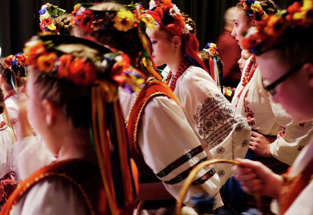 Members of the Ukrainian Zorepad Dance Ensemble gather off stage before going on to perform at the 41st Annual Festival of Nations at the Empire State Plaza Convention Center on Sunday, Oct. 27, 2013 in Albany, NY. (Paul Buckowski / Times Union)