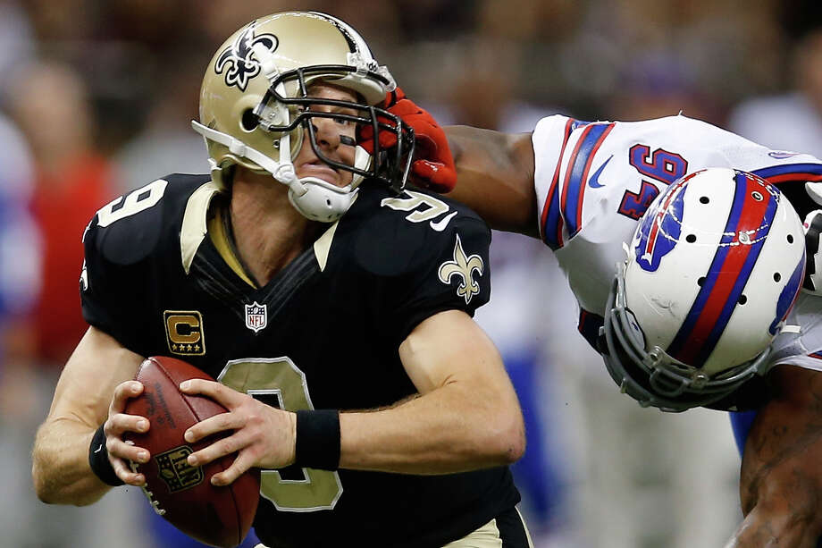 NEW ORLEANS, LA - OCTOBER 27:   Drew Brees #9 of the New Orleans Saints is pulled by the facemask by  Mario Williams #94 of the Buffalo Bills at Mercedes-Benz Superdome on October 27, 2013 in New Orleans, Louisiana.  (Photo by Chris Graythen/Getty Images) ORG XMIT: 181225404 Photo: Chris Graythen / 2013 Getty Images