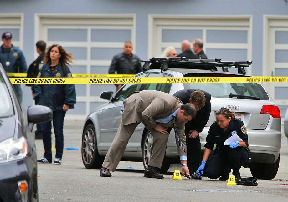 Investigators are seen at the scene of an officer involved shooting at Mallorca way and Capra way in San Francisco, Calif. on Saturday, Oct. 27, 2013. Photo: Raphael Kluzniok, The Chronicle