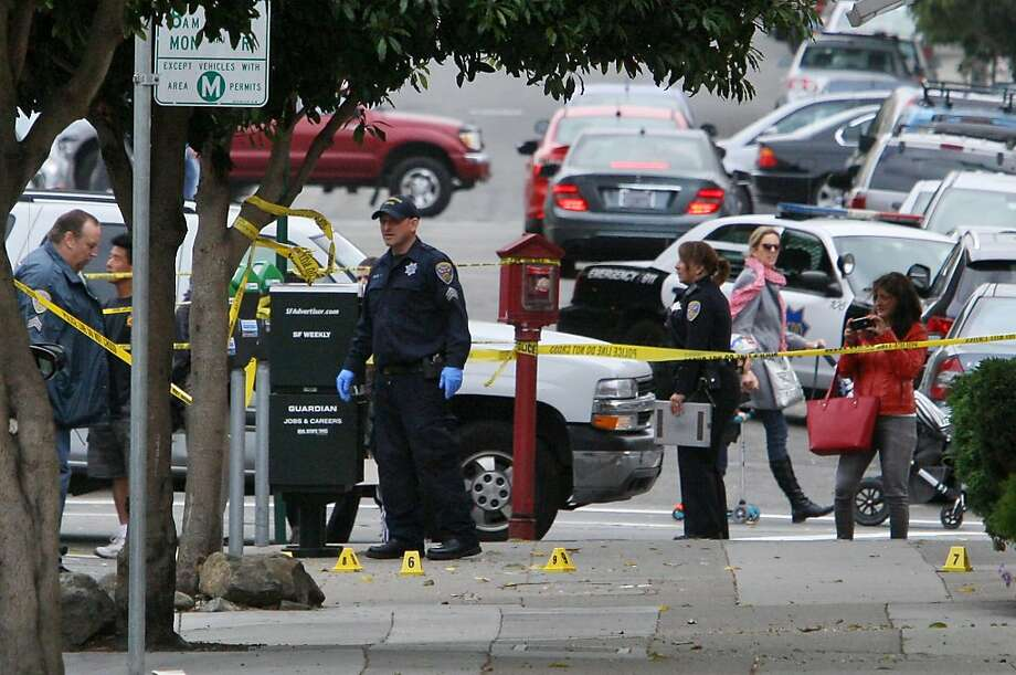 Investigators are seen at the scene of the altercation on Pierce and Chestnut which led to an officer involved shooting on Mallorca way  and Capra way in San Francisco, Calif. on Saturday, Oct. 27, 2013. Photo: Raphael Kluzniok, The Chronicle
