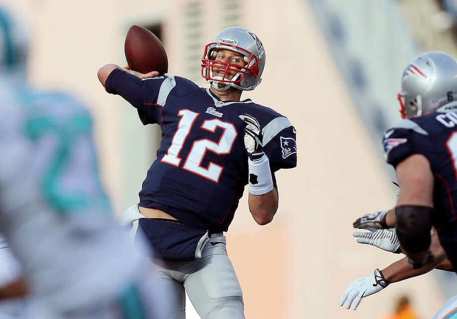 New England Patriots quarterback Tom Brady passes against the Miami Dolphins in the second half of an NFL football game Sunday, Oct. 27, 2013, in Foxborough, Mass. (AP Photo/Michael Dwyer) ORG XMIT: FBO122 Photo: Michael Dwyer / AP