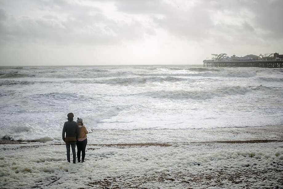 BRIGHTON, UNITED KINGDOM - OCTOBER 27: Members of the public brace the stormy weather conditions on October 27, 2013 in Brighton, UK. Millions of people in parts of the UK have been told to brace themselves for what is predicted to be one of the worst storms for years with heavy rain and hurricane-force winds expected tonight and tomorrow morning as the storm hits the South West then moves north and eastwards. (Photo by Dan Dennison/Getty Images) *** BESTPIX *** Photo: Dan Dennison, Getty Images