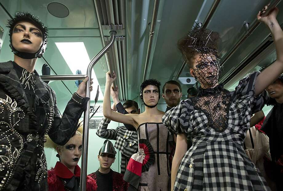 Models wearing collections of previous editions of the Sao Paulo Fashion Week, ride a subway train in Sao Paulo, Brazil, Sunday, Oct. 27, 2013. About 40 models participated in the event to promote the Sao Paulo Fashion Week, which runs from Oct. 28 until Nov. 1. (AP Photo/Andre Penner) Photo: Andre Penner, Associated Press