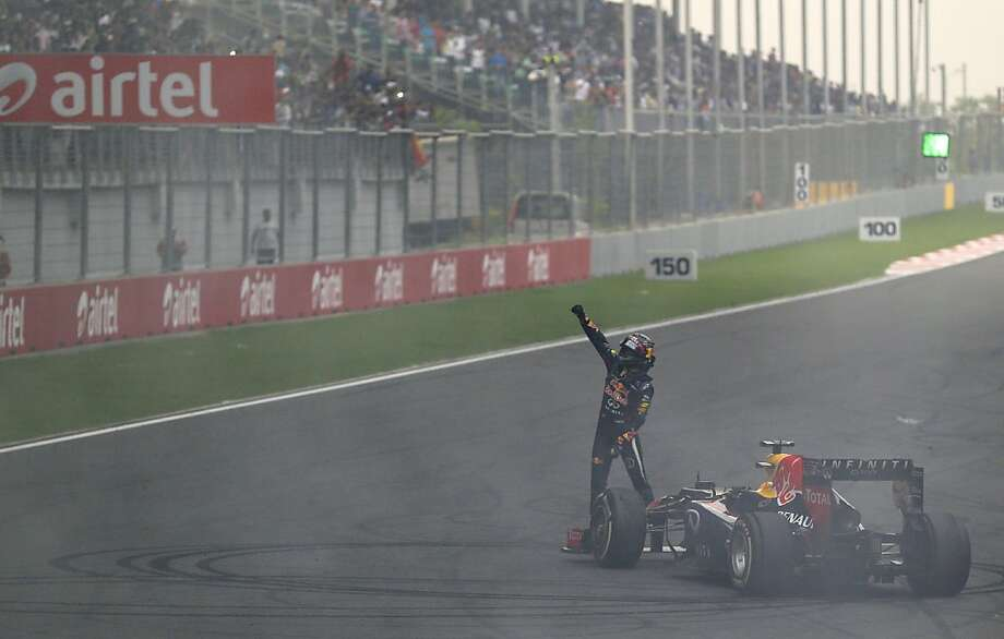 Red Bull driver Sebastian Vettel of Germany gestures to the crowd after winning the Indian Formula One Grand Prix and his 4th straight F1 world drivers championship at the Buddh International Circuit in Noida, India, Sunday, Oct. 27, 2013. (AP Photo/Saurabh Das) Photo: Saurabh Das, Associated Press
