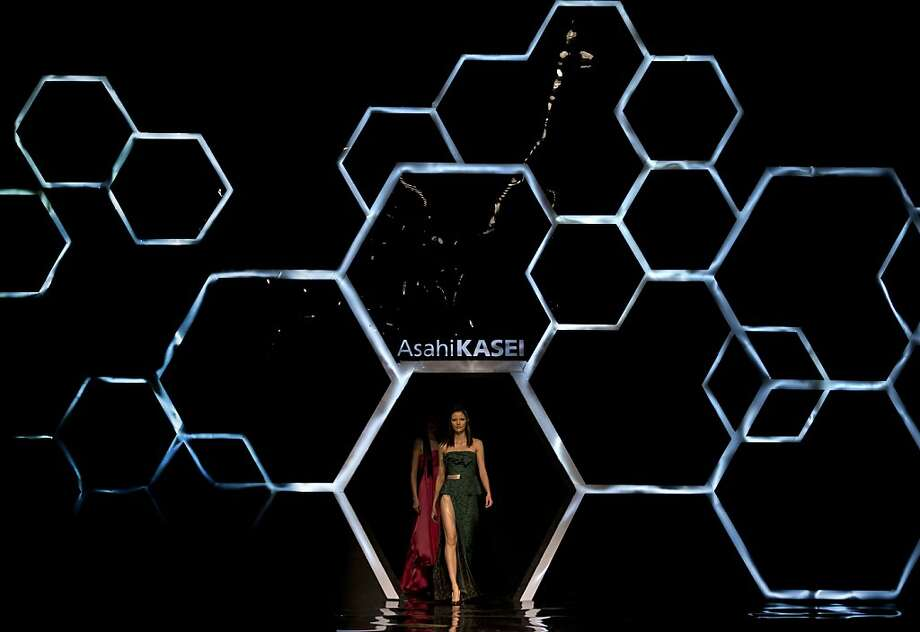 Models present a creations by Chinese designer Lu Shengqian during Mercedes-Benz China Fashion Week Spring/Summer 2014, in Beijing Sunday, Oct. 27, 2013. (AP Photo/Andy Wong) Photo: Andy Wong, Associated Press