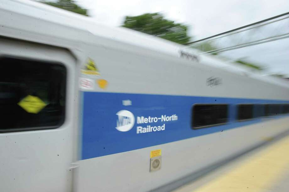 A Metro-North train exits the Mount Vernon East, N.Y., train station, Friday, Sept. 27, 2013. A damaged high-voltage feeder cable disrupted service along the New Haven Line for nearly two weeks. Photo: Bob Luckey / Greenwich Time