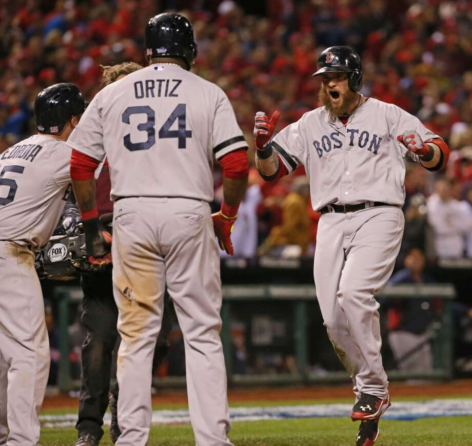 Game 4: Red Sox 4, Cardinals 2Best-of-seven series tied 2-2  Jonny Gomes of the Red Sox celebrates hitting a 3-run homer with Dustin Pedroia, left, and David Ortiz. Photo: Chris Lee, McClatchy-Tribune News Service