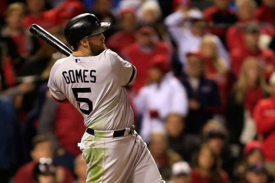 Jonny Gomes #5 of the Red Sox hits a three run home run to left field off Seth Maness. Photo: Dilip Vishwanat, Getty Images