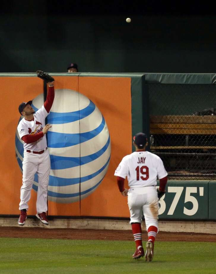 Matt Holliday reaches for a homer by Red Sox's Jonny Gomes. Photo: Huy Mach, McClatchy-Tribune News Service