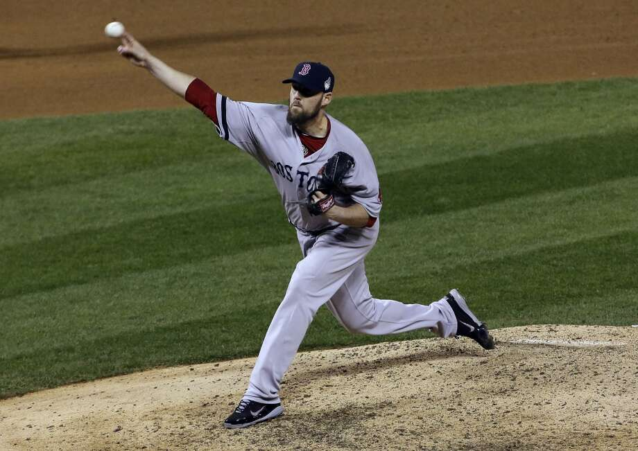 Red Sox relief pitcher John Lackey throws during the eighth inning. Photo: David J. Phillip, Associated Press