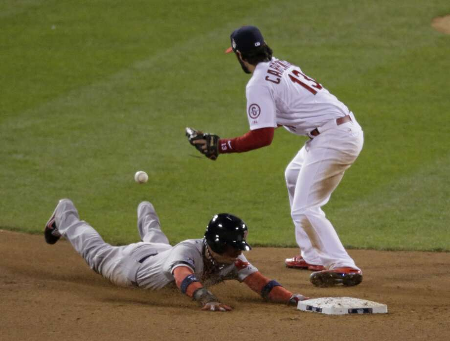 Quintin Berry steals second as Matt Carpenter takes the throw. Photo: Charlie Riedel, Associated Press