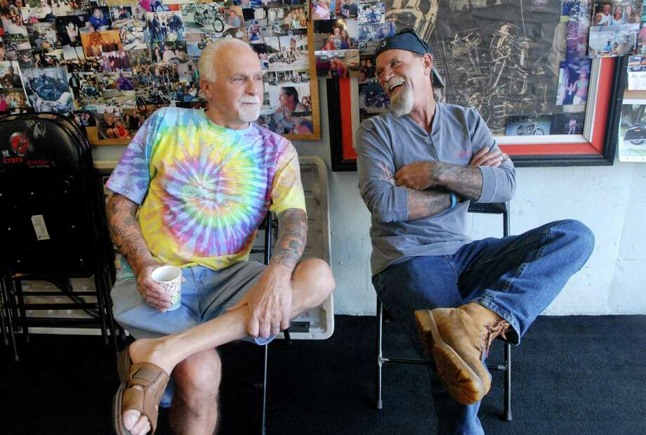 Dennis Arcano and Dan O'Connell hang out in Victor Chiappetta's garage, work on their motorcycles and drink coffee in the Cove section of Stamford, Conn. on Monday October 14, 2013. Photo: Dru Nadler / Stamford Advocate Freelance
