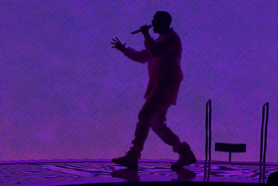 """NEWARK, NJ - OCTOBER 27:  Drake performs at the """"Would You Like A Tour?"""" Concert at Prudential Center on October 27, 2013 in Newark, New Jersey.  (Photo by Dave Kotinsky/Getty Images) Photo: Dave Kotinsky, Getty Images"""