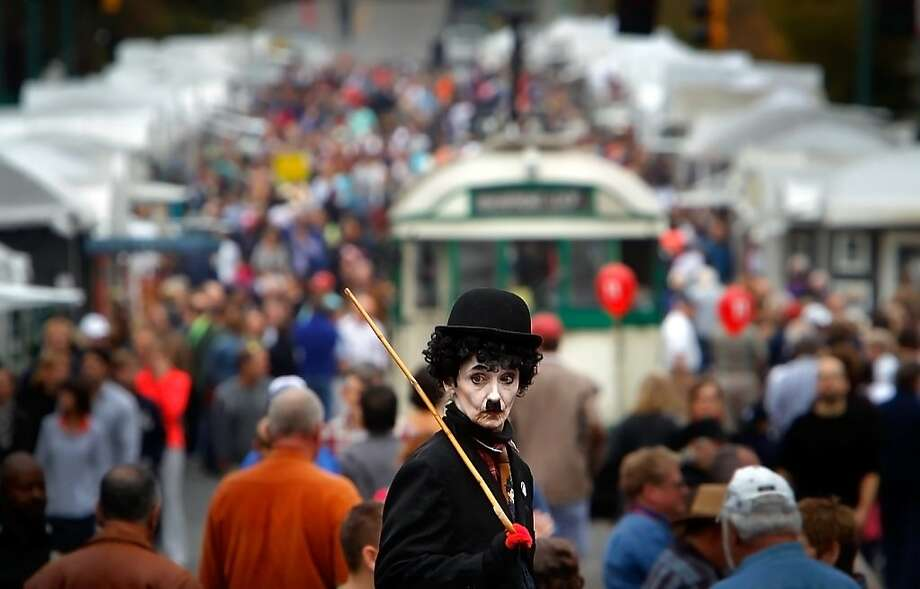 Lady is the Tramp:Charlie Chaplin (street performer Patricia Carreras) entertains at the RiverArtsFest in Memphis, Tenn. More than 190 artists turned out to show their works at the Mid South's largest juried arts show and street festival. Photo: Jim Weber, Associated Press