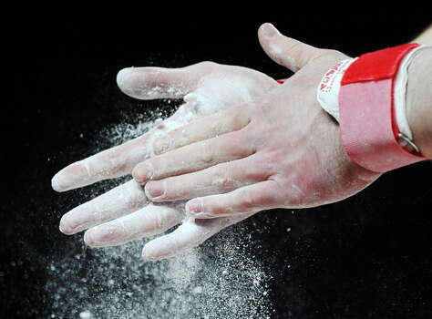 Gymnast chalk. Gymnasts use this stuff and they go flying through the air and jump around like rabbits. Moving with a gymnast's skill might save you. Get the chalk. Photo: PASCAL GUYOT, Getty Images  / 2012 AFP